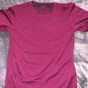 Burgundy Dri-fit nike shirt.